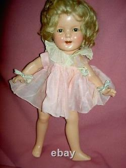 13 compo. Sgnd. Ideal Shirley Temple doll, original wig, tgd. Dress, clear eyes