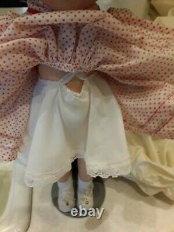 18 Shirley Temple Composition Doll with original shoes, socks, and slip