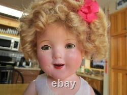 Vintage Shirley Temple compo doll, original tagged dress and pin, 18 AS-IS