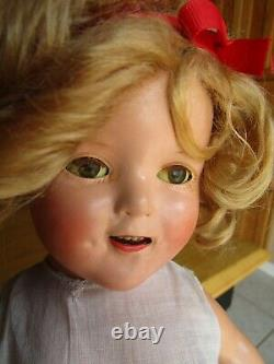 Vintage Shirley Temple composition doll withorig pin, replaced dress, 17 AS-IS